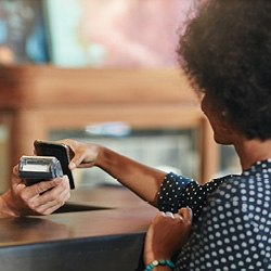 Woman paying with smart phone