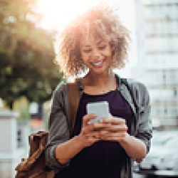 picture of a woman looking at her phone