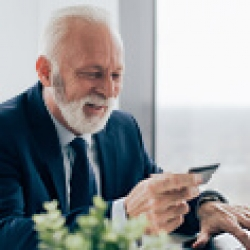 picture of a man looking at his phone