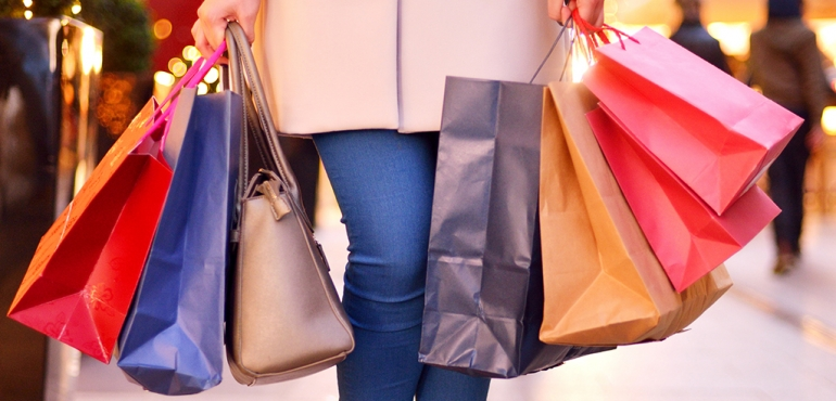 picture of someone carrying lots of shopping bags