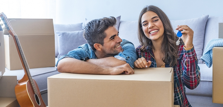 picture of a couple packing a box